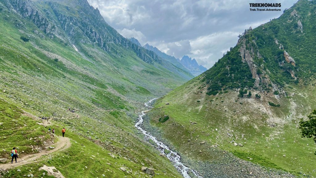 After crossing the tree-line, we reached Tabletop. We had hot Maggie, our packed lunch and started descending to this beautiful and expansive valley. We had to trek from another 6-7 kms to reach out camp 2. Kashmir Great Lakes Trek - Premium