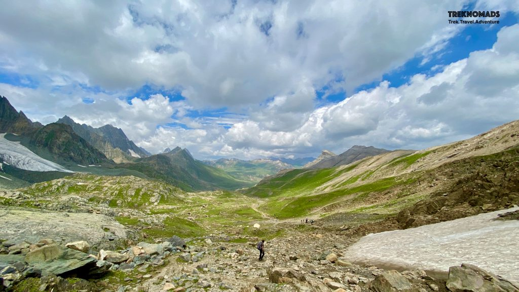 """After crossing the Nichnai Pass, we came across the most beautiful trail while descending. The trail was """"walk in the park"""". We walked on the soft grass almost the entire trail. Our camp was around 4-5 kms away near Vishansar lake from here. Kashmir Great Lakes Trek - Premium"""