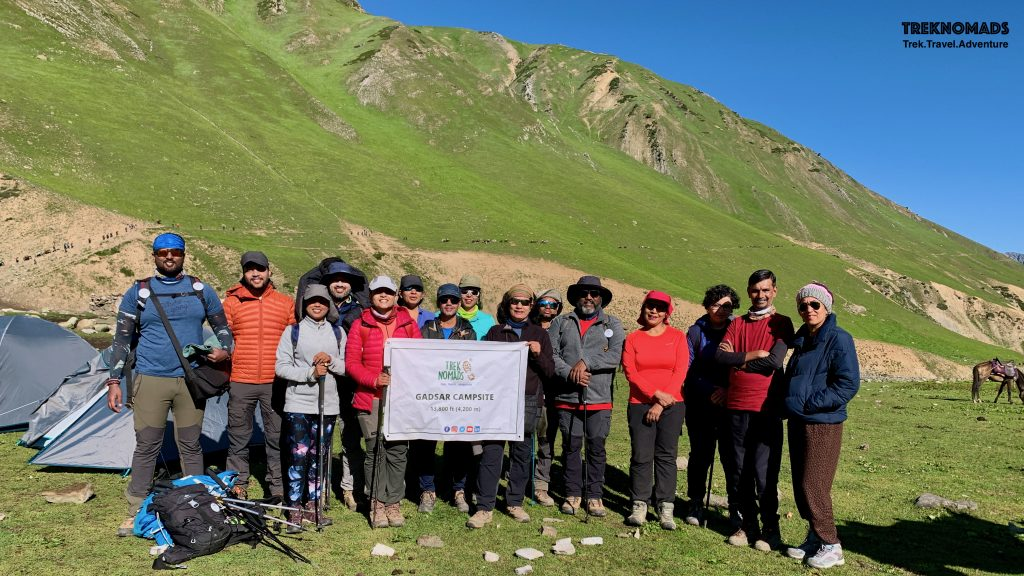 Group posing at Gadsar Campsite. We were ready to trek to Satsar lake and campsite. If lucky, we would also see the great Nanga Parbat - which is world's 9th highest mountain. - Kashmir Great Lakes Trek, Premium